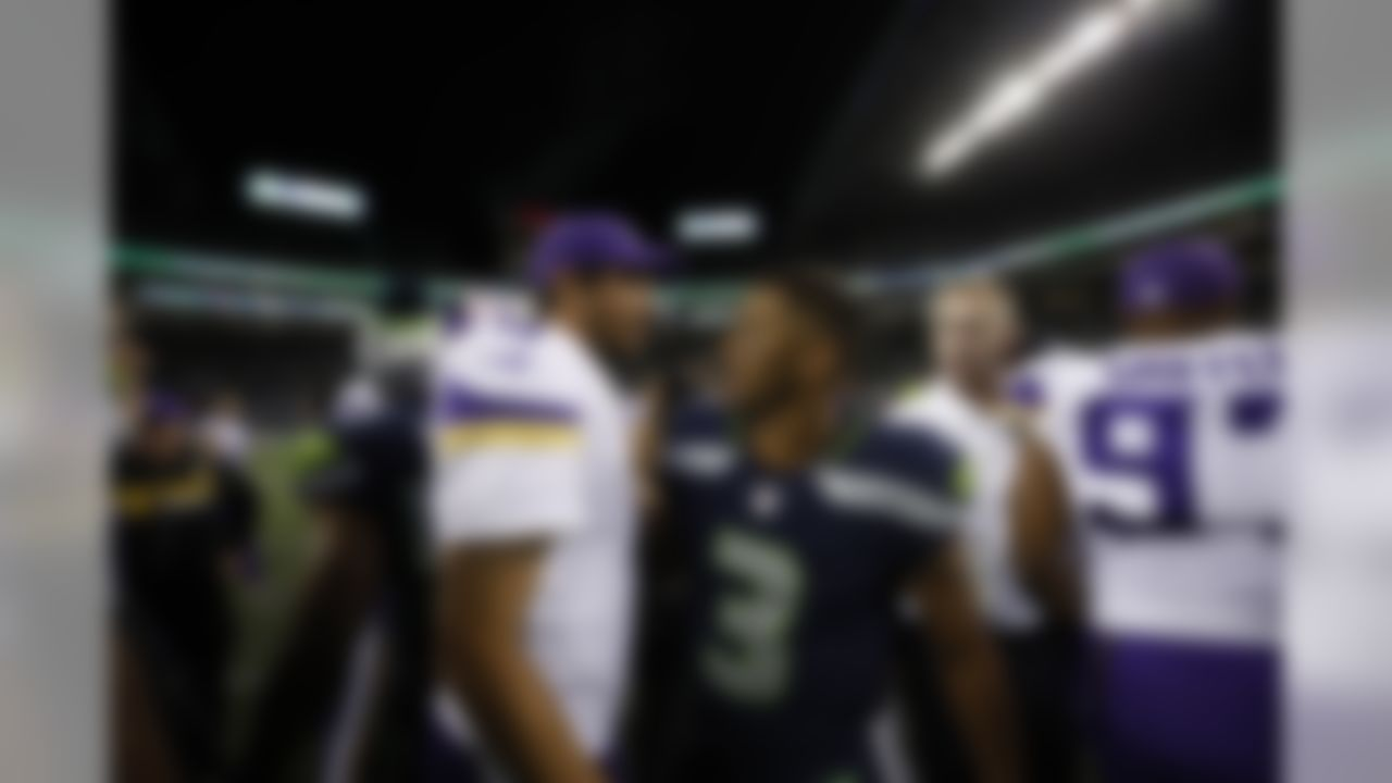 Minnesota Vikings quarterback Sam Bradford and Seattle Seahawks quarterback Russell Wilson pose for a photo during an NFL preseason game on Thursday, Aug. 18, 2017 in Seattle. (Ric Tapia/NFL)