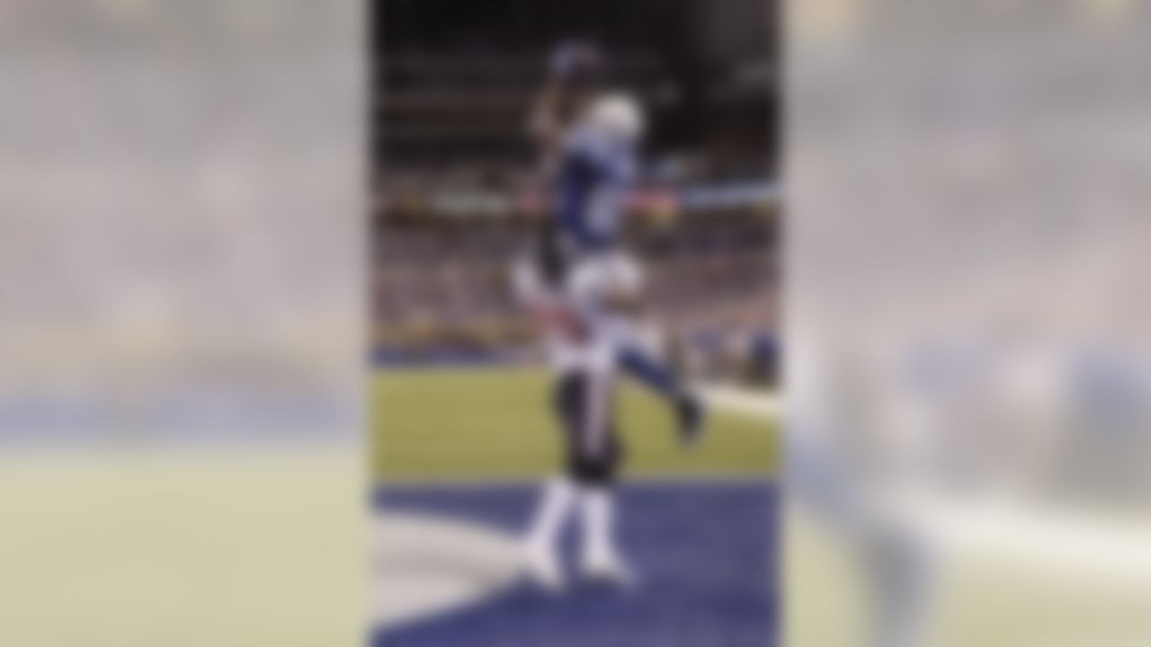 Indianapolis Colts' Reggie Wayne makes a touchdown reception against Houston Texans' Kareem Jackson during the fourth quarter of an NFL football game Thursday, Dec. 22, 2011, in Indianapolis. Indianapolis won 19-16. (AP Photo/AJ Mast)