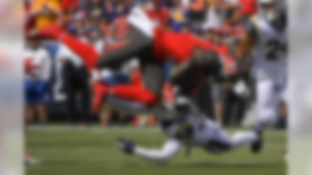 Tampa Bay Buccaneers wide receiver Chris Godwin is tackled by Los Angeles Rams free safety Eric Weddle during the first of an NFL football game Sunday, Sept. 29, 2019, in Los Angeles. (AP Photo/Mark J. Terrill)