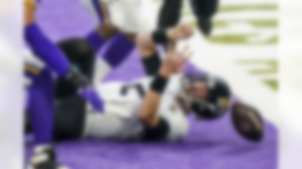 Jaguars quarterback Mike Glennon is sacked for a safety in the fourth quarter against the Minnesota Vikings. Jacksonville lost in overtime, 27-24.