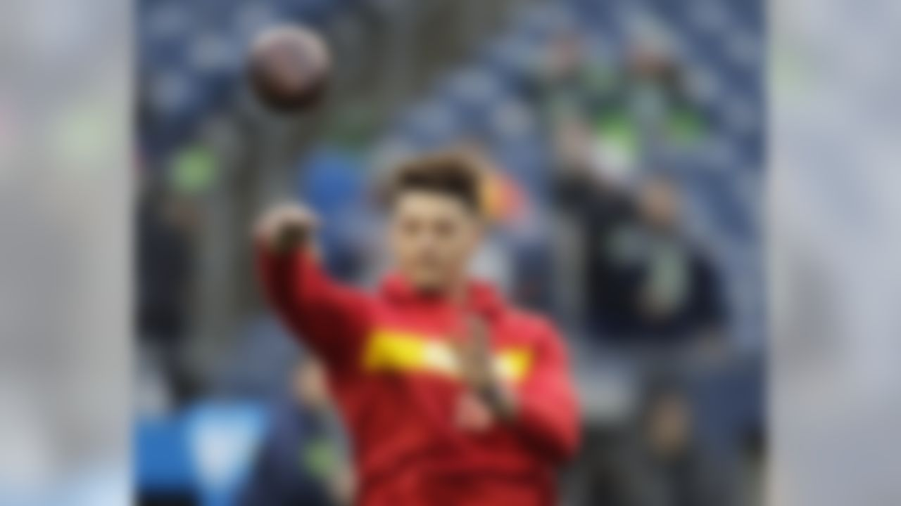 Kansas City Chiefs quarterback Patrick Mahomes passes during warmups before an NFL football game against the Seattle Seahawks, Sunday, Dec. 23, 2018, in Seattle. (AP Photo/Stephen Brashear)