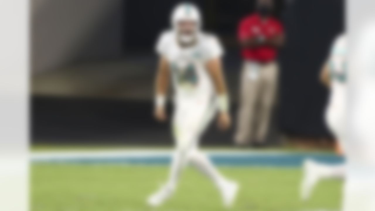 Miami Dolphins quarterback Ryan Fitzpatrick (14) celebrates during NFL football game against the Jacksonville Jaguars on Thursday, September 24, 2020 in Jacksonville, Florida.