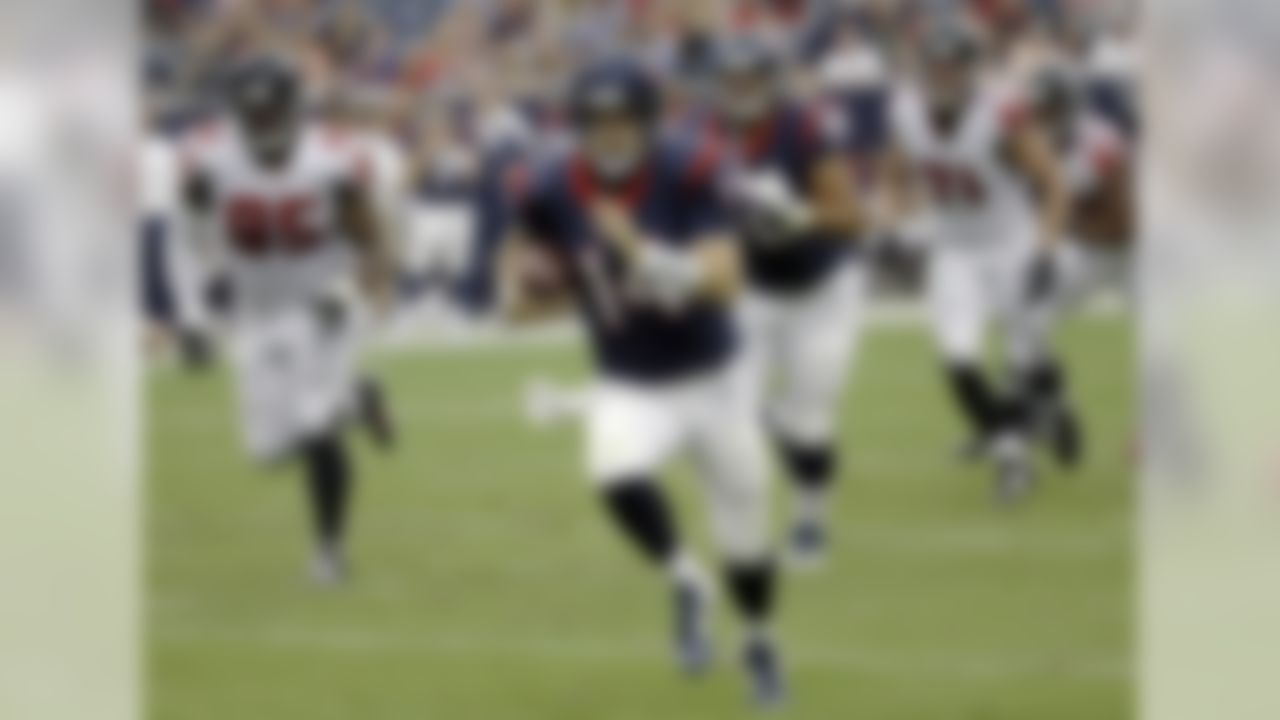 Houston Texans' Ryan Fitzpatrick (14) scrambles against the Atlanta Falcons during the first quarter of an NFL preseason football game Saturday, Aug. 16, 2014, in Houston. (AP Photo/David J. Phillip)