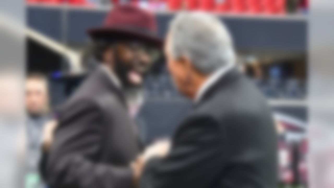 Former NFL player Ed Reed Jr. speaks with Atlanta Falcons owner Arthur Blank before an NFL football game between the Atlanta Falcons and the Tampa Bay Buccaneers, Sunday, Nov. 24, 2019, in Atlanta. (AP Photo/John Amis)