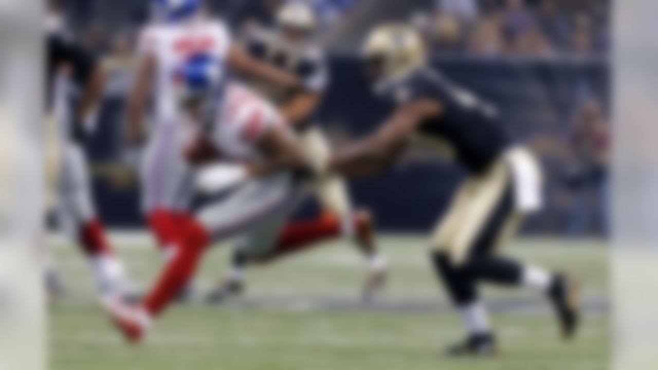 New York Giants wide receiver Odell Beckham (13) pulls in a reception as New Orleans Saints cornerback Delvin Breaux tries to tackle in the first half of an NFL football game in New Orleans, Sunday, Nov. 1, 2015. (AP Photo/Jonathan Bachman)