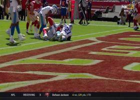 Garrett Celek muscles through two defenders into the end zone