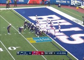 Joshua Kelley flies over goal-line pileup for fourth-down TD