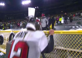 Tom Brady greets his son in the stands after NFC championship win
