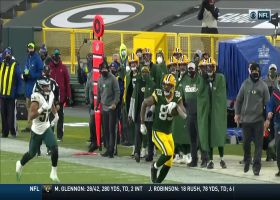 Rodgers flicks throw downfield to Lewis for 36-yard pickup