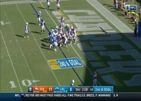 Philip Rivers stares motionless as Tyrod Taylor hands off the football