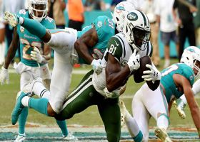 Qunicy Enunwa carries a pile of Dolphins for HUGE gain