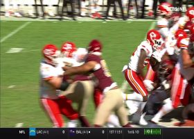 Darrel Williams hits the cutback lane to convert on fourth-and-1