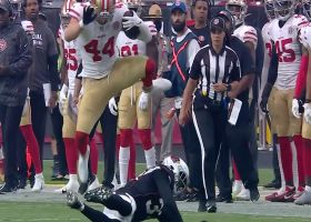 Kyle Juszczyk cleanly hurdles up and over would-be tackler