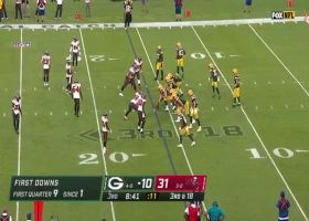 Rodgers navigates congested pocket for third-and-18 dime to Adams