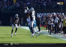 Marvin Jones climbs ladder for leaping catch in traffic