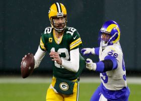 Rodgers keeps cool in own end-zone traffic, delivers 21-yard strike