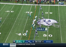 Fins' D chases down Brian Hoyer short of the marker for fourth-down stop
