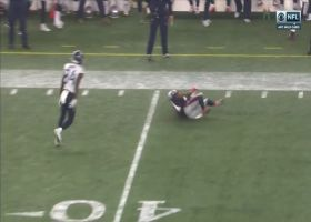 Harmon hauls in Tannehill's heave for outstanding diving INT