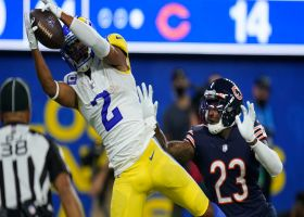 Woods climbs ladder to haul spectacular tip-toe TD