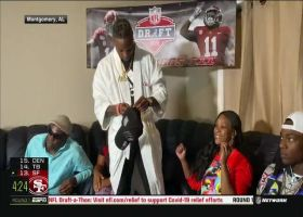 Henry Ruggs III sports robe after being drafted by Raiders