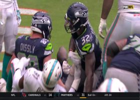 Chris Carson plows through goal-line pile for strong TD