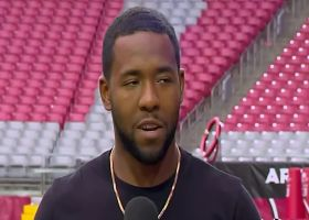 Budda Baker explains to Willie McGinest how he got his nickname as a kid