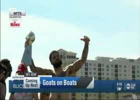 Mike Evans dances with Lombardi trophy during boat parade