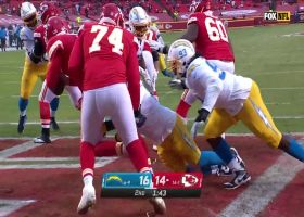 Isaac Rochell clamps down on Chad Henne for a safety sack
