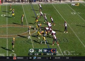 Justin Fields' speed helps him escape sack on 16-yard run