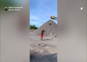 Marlon Humphrey sprints up gravel hill at construction site