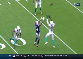 Diggs rips catch away from two Dolphins defenders