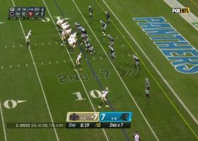 Brees sells the play fake on TD dart to Sanders over the middle