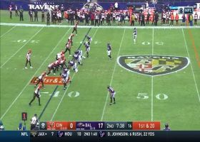Ravens D surrounds Joe Burrow as Pernell McPhee secures 7-yard sack