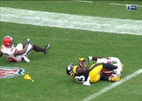 James Washington wrestles 'Duck' Hodges' TD bomb between two defenders