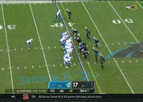 Stafford finds wide open Hockenson muscling his way for 35-yard gain