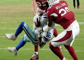 Reggie Davis goes up between two defenders for strong 32-yard grab