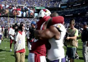 Terrell Suggs hugs former Ravens teammate Brandon Williams after game