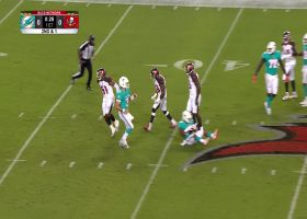 Minter greets RB in backfield JUST as he receives handoff