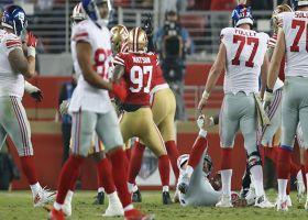 Buckner, Watson dig their way to sack Eli