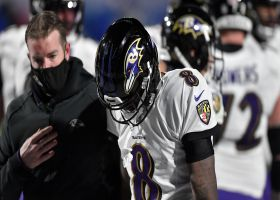 Lamar Jackson is slow to get up after errant snap end in intentional grounding