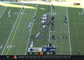 Aldon Smith engulfs Russell Wilson for his third sack of day