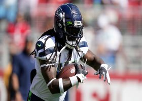 Russell Wilson rips pass to Alex Collins for 28-yard catch and run
