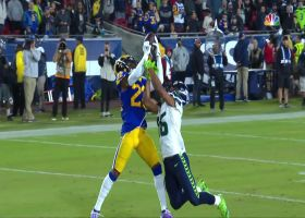 Troy Hill leaps over Lockett for end-zone interception